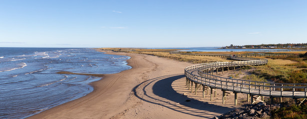 Panoramic view of a beautiful sandy beach on the Atlantic Ocean Coast. Taken in La Dune de Bouctouche, New Brunswick, Canada. Fototapete