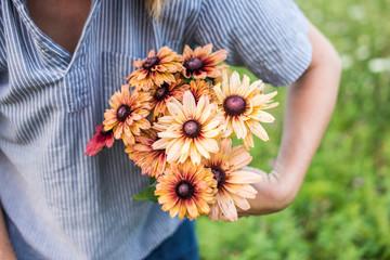 Woman showing a bouquet of freshly cut flowers