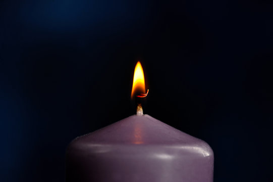 burning purple candle close-up