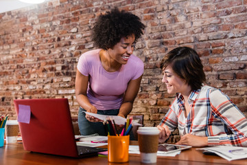 Attractive business women working at coworking office