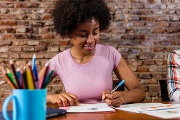 Black business woman reading report