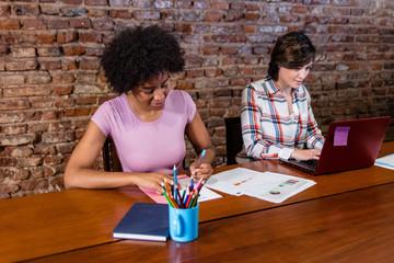 Business women doing paper work