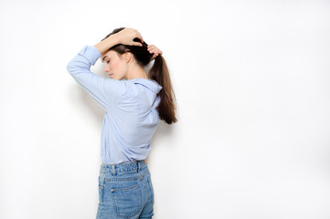 Young pretty woman against white background
