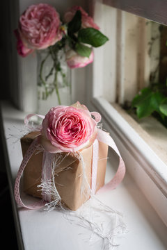 pretty gift with ribbon and pink rose