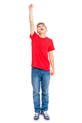 Full length portrait of young caucasian teen boy, isolated on white background. Funny teenager - Superhero with raised up one hand. Handsome child plays superman in studio.