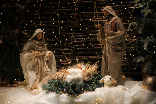 Christmas Manger scene with figures including Jesus, Mary, Joseph, sheep and magi.