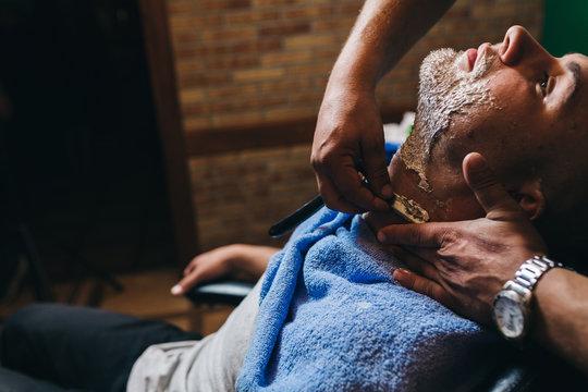Man been shaved in barbershop