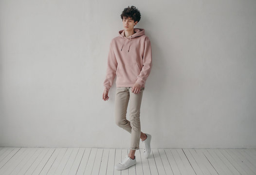 Stylish young man in hoodie