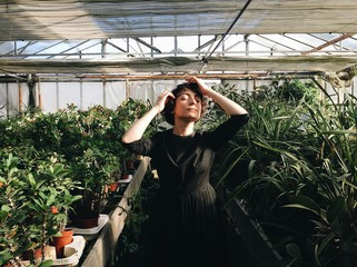 A woman in a greenhouse