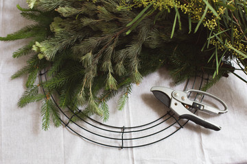 Creating a Christmas wreath from plant foliage and native Australian flowers.