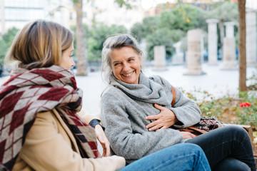 Elderly woman laughing at joke