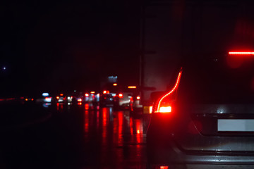 Traffic on a wet wet road