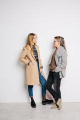 Women in coats having chat
