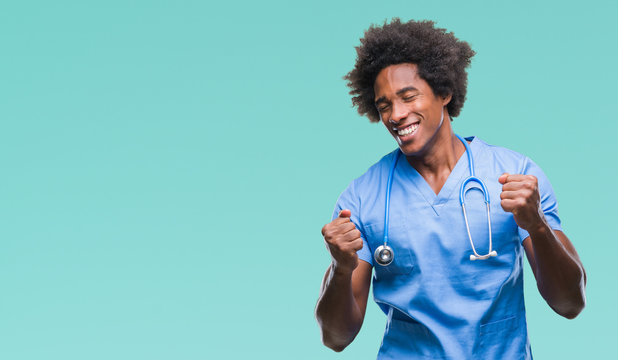 Afro american surgeon doctor man over isolated background very happy and excited doing winner gesture with arms raised, smiling and screaming for success. Celebration concept.