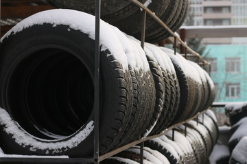 winter tires under snow on the street. winter is come