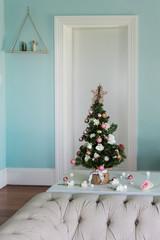 small xmas tree on sofa tablein living room