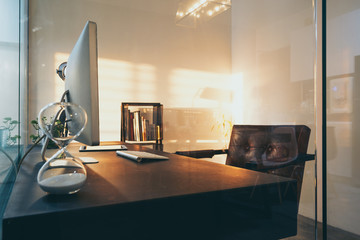 Loft and cozy interior design office with glass wall partition .