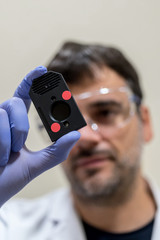 Scientific with expression chip in a DNA laboratory