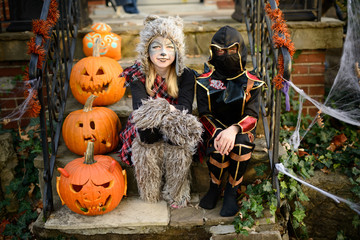 Two children dressed as a bear and a Ninja for Halloween show of