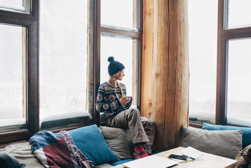 Woman Enjoying Tea in Ski Lodge