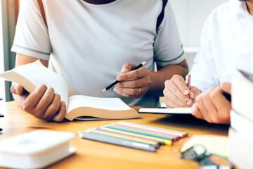 Two student doing homework in university.
