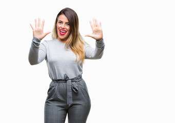 Young beautiful worker business woman over isolated background showing and pointing up with fingers number ten while smiling confident and happy.