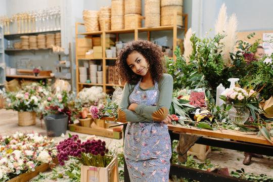 Charming woman posing in flower market