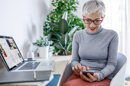 Businesswoman Typing on Cell Phone
