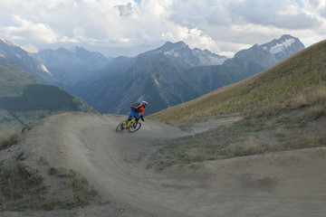 Man mountain biking downhill backcountry route in the Alps