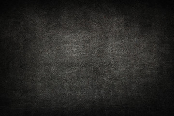 Old black background. Grunge texture. Dark wallpaper. Blackboard. Chalkboard