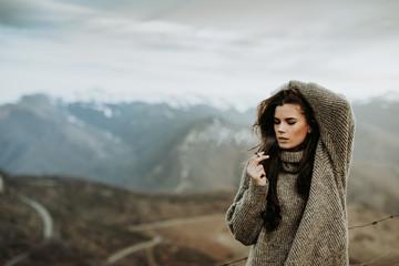 Woman smoking marihuana at mountain