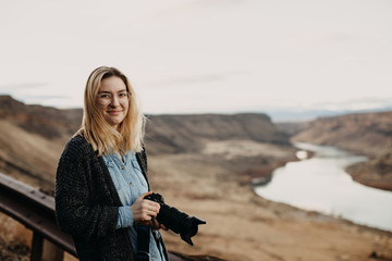Portrait of Female Photographer overlooking Scenic Canyon Landscape