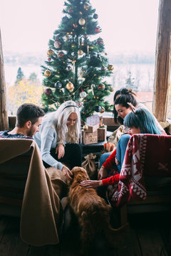 Group of friends spending time together at home for Christmas