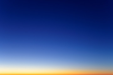 real natural color of clear winter cold sunset sky with sun below horizon line nature atmosphere panorama landscape skyline background