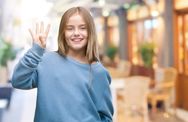 Young beautiful girl wearing winter sweater over isolated background showing and pointing up with fingers number four while smiling confident and happy.