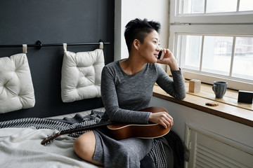 Young musician talking on phone