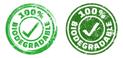 100% biodegradable stamps in green and dark green colors. Grunge texture. Vector illustration.
