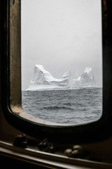 Vintage sailing vessel and Icebergs floating in the arctic
