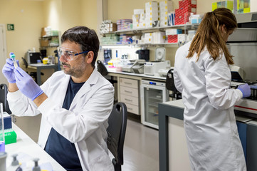 Two scientists working in a DNA lab
