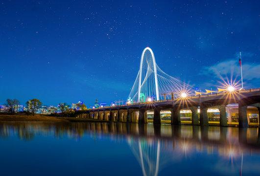 Margaret Hunt Hill Bridge at night in Dallas, Texas,Margaret Hunt Hill Bridge and Dallas downtown skyline.