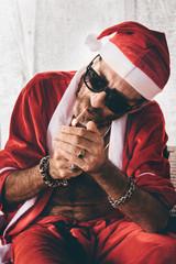 Santa lighting a cigarette