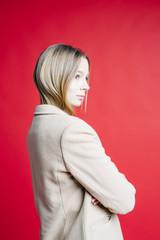 Confident woman in coat