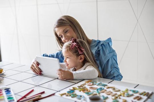 Mother and Child Using Tablet