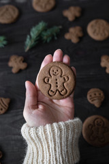 Woman holding just baked Christmas cookie