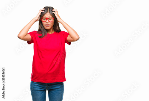 6eb8f1f8892 Young asian woman wearing glasses over isolated background suffering from  headache desperate and stressed because pain