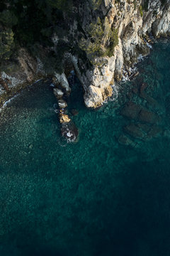 Drone view of cliff and transparent water of Mediterranean sea.