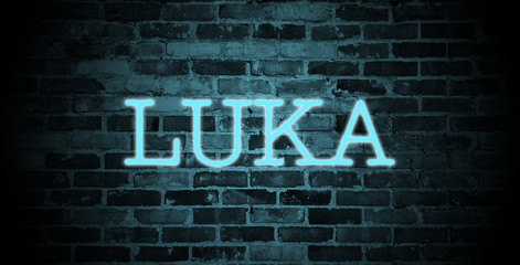 first name Luka in blue neon on brick wall
