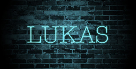 first name Lukas in blue neon on brick wall