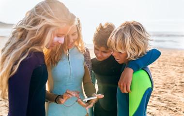 Three teenage friends and their surf teacher