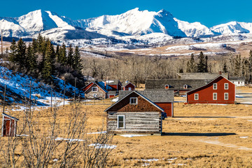 Rustic out buildings under the foothills, Bur U Ranch, National Historic Site, Alberta, Canada